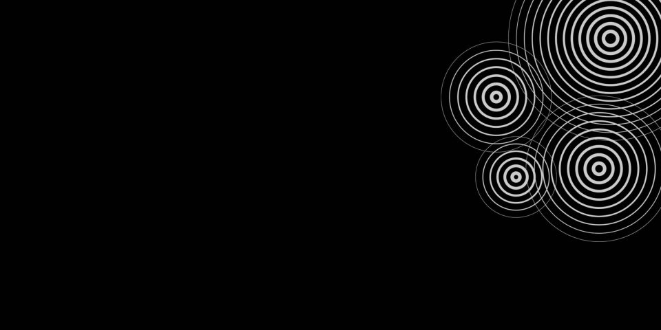 Four overlapping radial graphics in white on black background