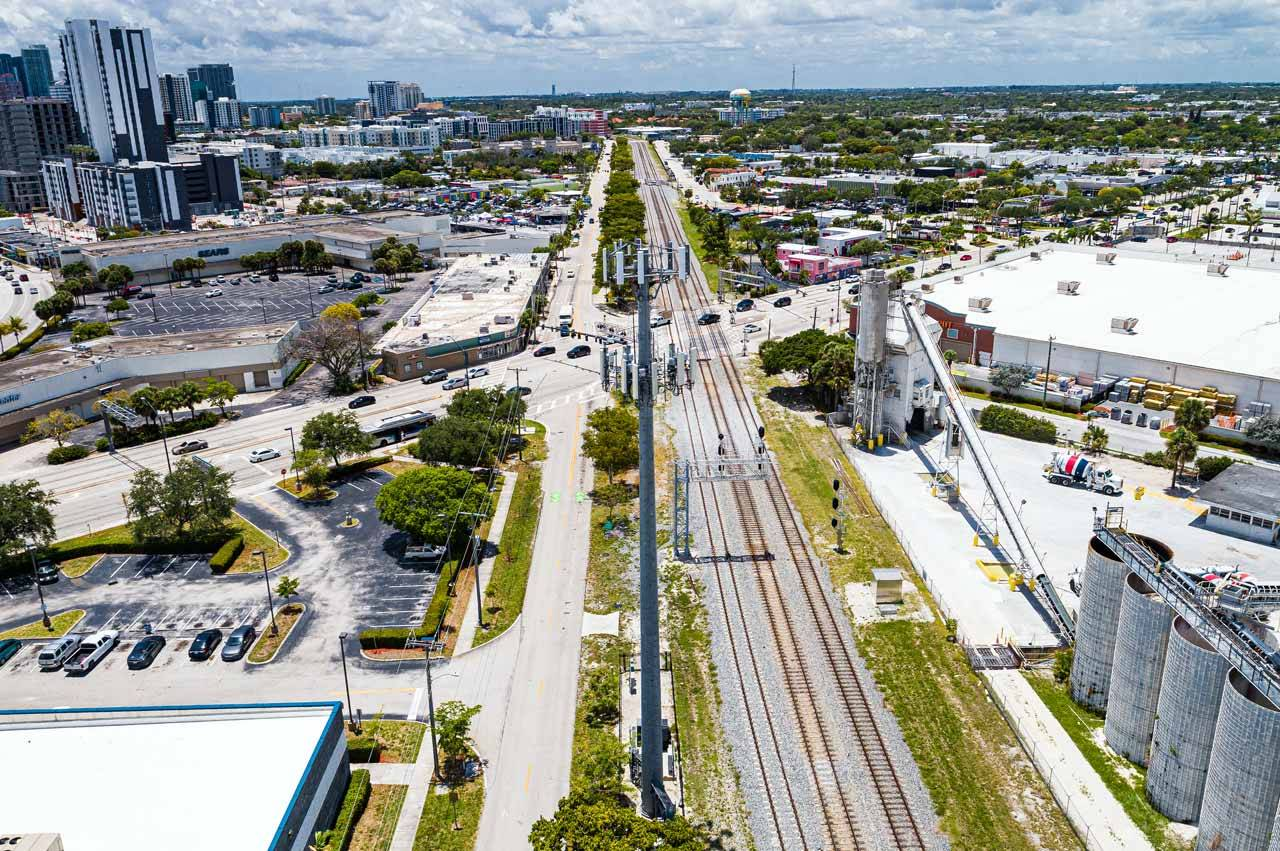 Cell tower next to highway in Fort Lauderdale built by telecom tower company Parallel Infrastructure